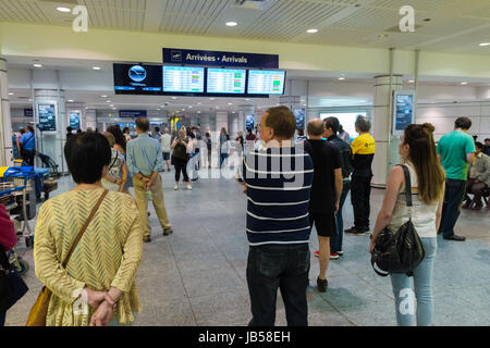 Montreal, CANADA - 8 June 2017: Family and friends waiting at arrivals gate at Pierre Elliott Trudeau International - Stock Photo