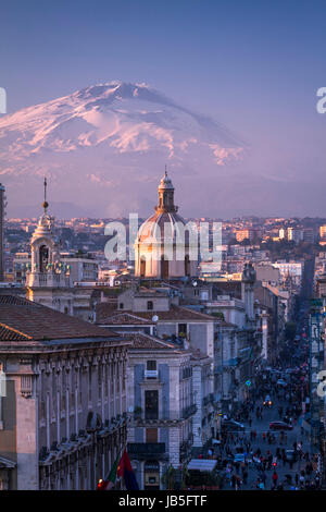 Catania, the city center with Mt. Etna volcano, covered with snow, on the background, Sicily, Italy. - Stock Photo