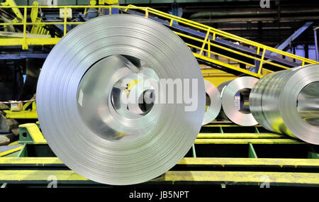 sheet tin metal rolls inside of plant - Stock Photo