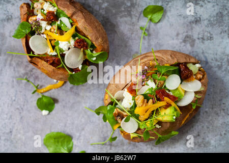 Baked sweet potato with salad - Stock Photo