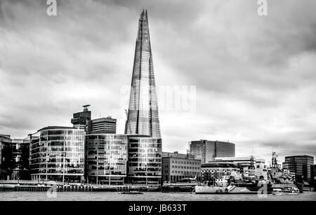 London, 2017 march, United Kingdom: View from the north shore of the Thames Historic HMS Belfast cruiser anchored - Stock Photo
