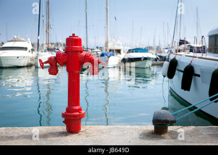 Marine fire hydrant on the quay in front of the yachts - Stock Photo
