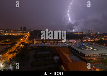 Lightning bolts captured during a tropical storm in Johor, Malaysia - Stock Photo