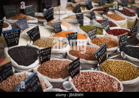 Sacks of beans and grains for sale in a market, Curitiba, Brazil. - Stock Photo
