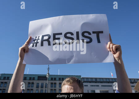 Berlin, Germany. 2nd June, 2017. Demonstrators hold signs to protest against President Trump's decision to pull out of the Paris Agreement, near the Brandenburg Gate. Credit: Omer Messinger/ZUMA Wire/Alamy Live News Stock Photo