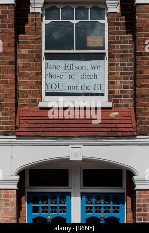 Battersea, London, UK. 9th Jun, 2017. Posters in a battersea flat window celebrate Jane Ellisons defeat - highlighting her failure to listen to her electorate when she voted for article 50 despite them voting heavily to stay in the EU (the flat previously had pro Lib Dem and Labour posters in its windows). Labour overturned Conservative minister Jane Ellison's majority of almost 8,000 in the London seat of Battersea, in the first major scalp of the general election. Credit: Guy Bell/Alamy Live News Stock Photo