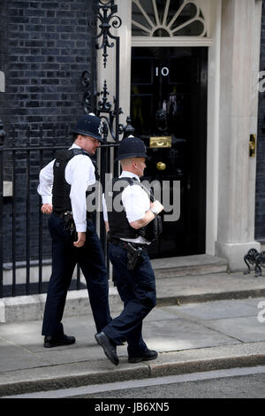 Police patrolling at Number 10 Downing Street, London, UK. Security at Downing St - Stock Photo