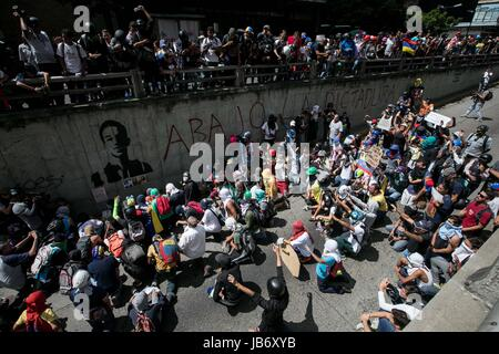 Caracas, Venezuela. 09th June, 2017. A group of young people participate in a demonstration in Caracas, Venezuela. - Stock Photo
