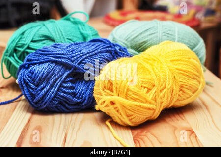 Nice multi-colored skeins of wool in room - Stock Photo