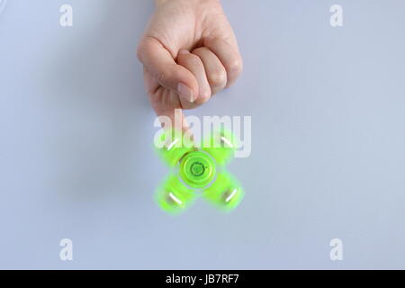 Toy stress Fidget spinner hand for child and adult colorful - Stock Photo