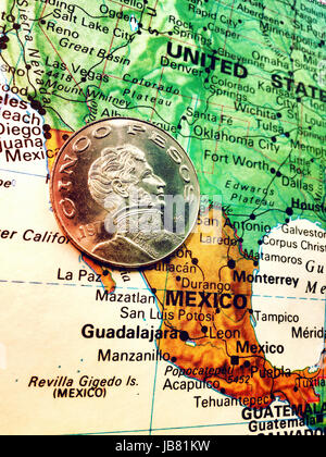 Mexican Coin on World Map Still Life - Stock Photo