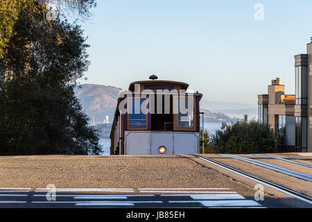 A view of a cable car cresting a hill in San Francisco - Stock Photo