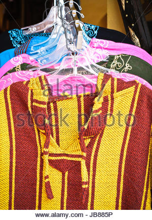 Traditional moroccan clothes in a market stall - Stock Photo