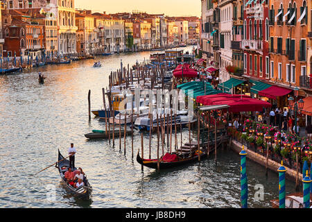 Panoramic view of famous Canal Grande from famous Rialto Bridge at sunset in Venice, Italy - Stock Photo