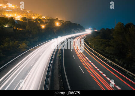 Light trails showing motion of the cars on a highway in the usa, united states at night - Stock Photo