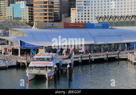 People visit Darling Harbour in Sydney Australia. - Stock Photo