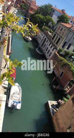 A narrow side canal off the Grand Canal in Venice, Italy - Stock Photo