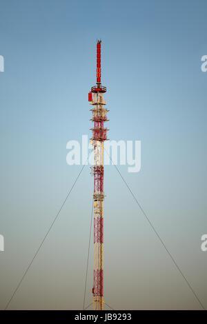 Transmitter tower detail against blue sky - Stock Photo