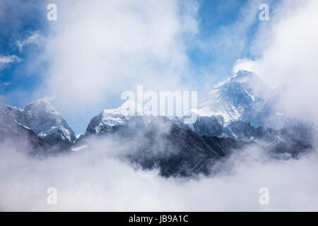 Mount Everest revelaed throught the clouds.  Sagarmatha National Park in the Himalayas of Nepal. - Stock Photo