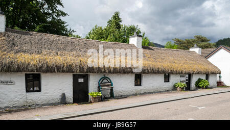 Glencoe & North Lorn Folk Museum in restored longhouse with thatched roof, Lochaber, Scottish Highlands, Scotland, - Stock Photo