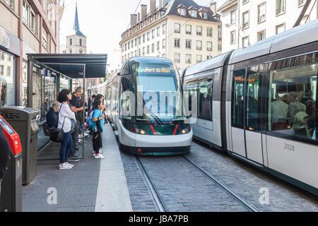 Porte de l'Hôpital tram stop in central Strasbourg, France. People waiting, Alstom Citadis tram Port du Rhin. - Stock Photo
