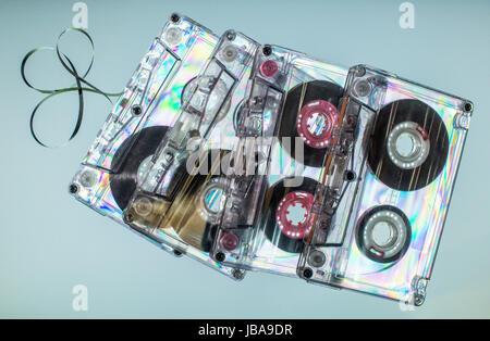 Vintage cassette tapes on light blue background - Stock Photo