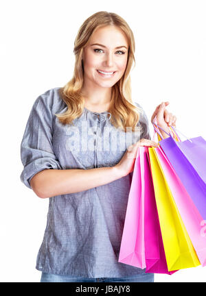 Happy shopper girl with four colourful paper bags isolated on white background, doing purchase, sale and spending - Stock Photo