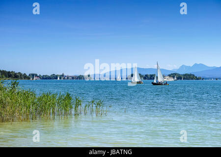 Floating yachts on lake Chiemsee - Stock Photo