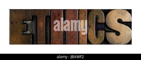 The word ETHICS written in vintage letterpress type - Stock Photo