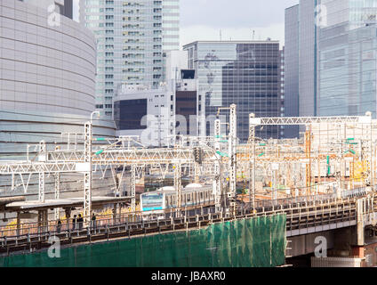railway with skyline at yurakucho near ginza Tokyo Japan for transportation background - Stock Photo