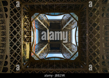 Eiffel tower seen from below; Paris, France - Stock Photo
