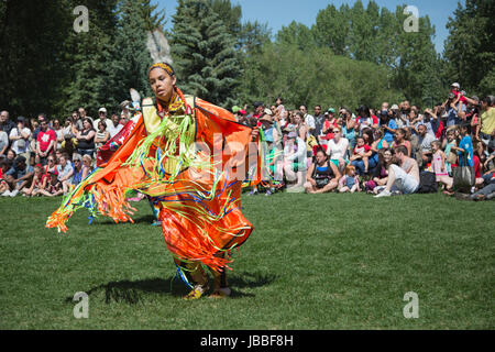 Woman dancing at First Nations powwow on Canada Day - Stock Photo