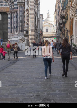 GENOA, ITALY - MARCH 16, 2014: Tourists visiting the old town area in spring - Stock Photo