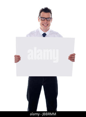 Smiling male representative holding blank signboard - Stock Photo