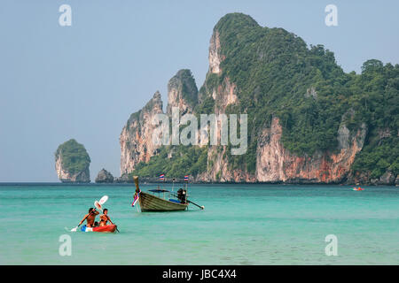 People kayaking at Ao Loh Dalum on Phi Phi Don Island, Krabi Province, Thailand. Koh Phi Phi Don is part of a marine - Stock Photo