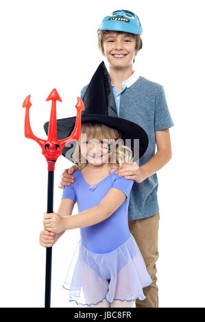 Boy and girl wearing Halloween costume. Dressed as vampire and witch. - Stock Photo