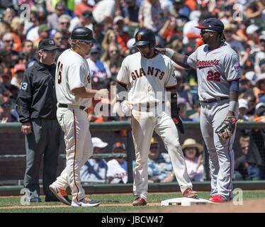San Francisco, California, USA. 10th June, 2017. San Francisco Giants third baseman Eduardo Nunez (10) gets congratulations - Stock Photo