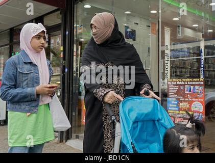 Muslim women - presumable a family - walking on 37th Ave in Jackson Heights, Queens, New York City - Stock Photo