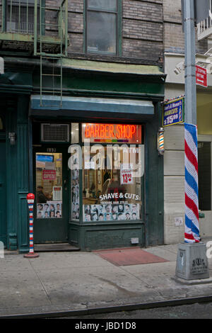 Shave & Cuts Barber Shop on Christopher Street in Greenwich Village, Manhattan, New York City. Note the 2 homemade - Stock Photo