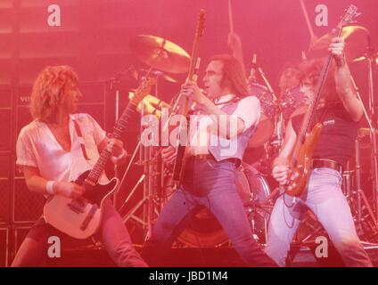 STATUS QUO - Rick Parfitt, Francis Rossi, John Coghlan, Alan Lancaster  - performinglive on 'Can't Stand The Heat - Stock Photo