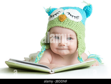baby infant in funny owl knitted hat owl with book on white background - Stock Photo