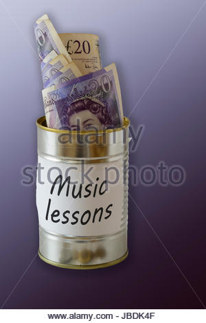 Music lessons, cash kept in a tin can, England, UK - Stock Photo