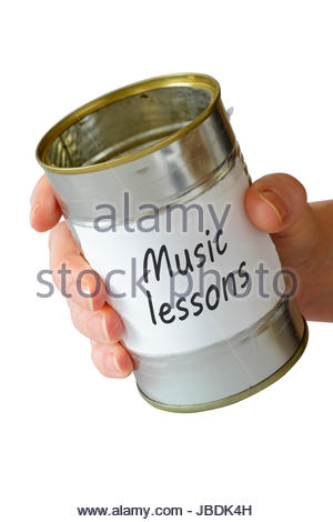 Music lessons, empty begging can, England, UK - Stock Photo