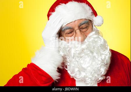 Santa claus suffering from headache - Stock Photo