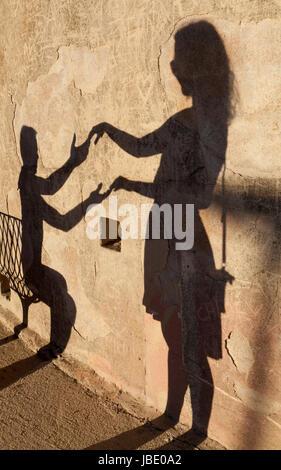 Shadows of two people. Bonifacio, Corsica, France. - Stock Photo