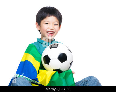 Asia little boy with brazil flag and soccer ball - Stock Photo