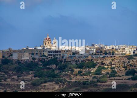 Victoria city skyline with Saint George Basilica - Victoria, Gozo, Malta - Stock Photo