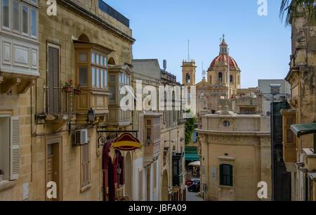 Victoria city street with Saint George Basilica red dome - Victoria, Gozo, Malta - Stock Photo