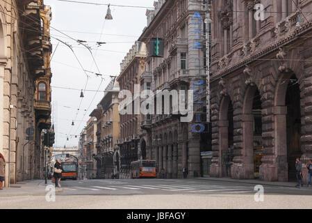 GENOA, ITALY - MARCH 16, 2014: Tourists in Via XX Settembre high street - Stock Photo