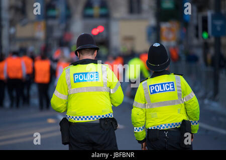 Police officers on patrol in central Cardiff during the Champions League final in Cardiff, Wales, UK. - Stock Photo